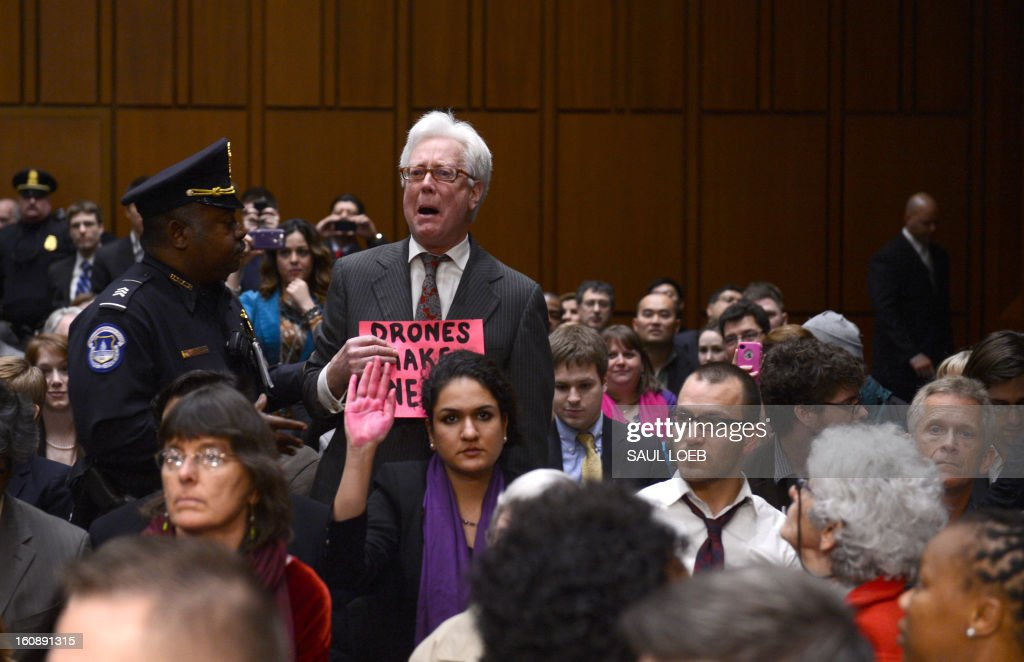 Demonstrators disrupt the confirmation hearing of John Brennan, US President Barack Obama's nominee to be director of the Central Intelligence Agency (CIA), before the Senate Intelligence Committee on Capitol Hill in Washington, DC, on February 7, 2013. The hard-nosed architect of the US drone war against Al-Qaeda, John Brennan, will on Thursday face difficult questions about secret assassinations from senators weighing his nomination to lead the CIA. AFP PHOTO / Saul LOEB