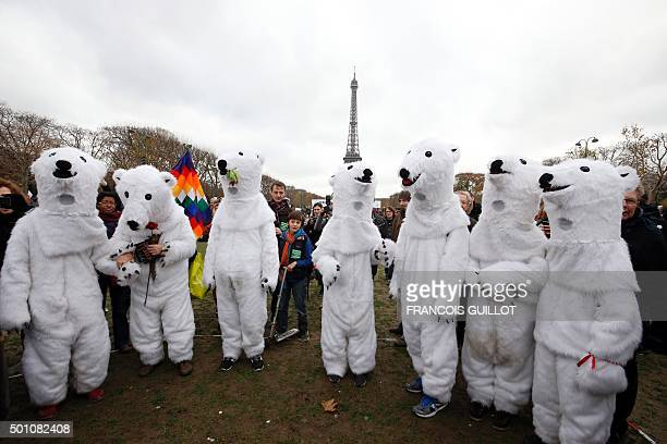 Demonstrators dressedup as polar bears take part to a rally called by several Non Governmental Organisations to form a human chain on the Champs de...