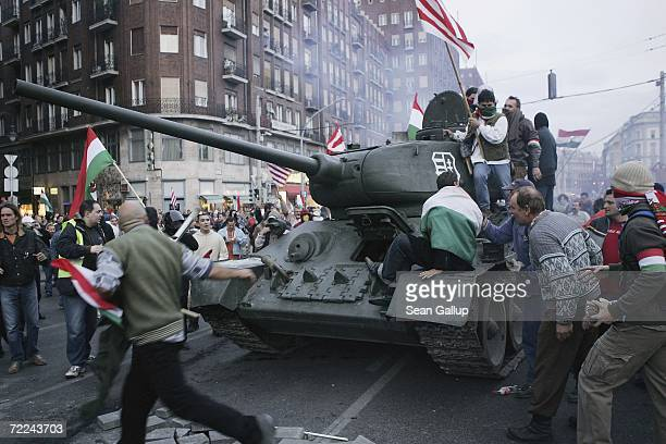 Demonstrators driving a 1950sera tank they had commandeered drive through other massed demonstrators on their way to charging a police cordon during...