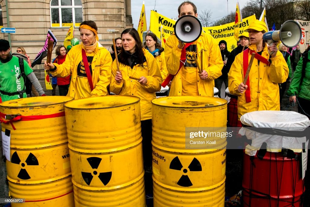 Demonstrators drum on yellow barrels at a march to demand a faster transition to renewable energy sources on March 22, 2014 in Postdam, Germany. Similar protests are being held across Germany today as Germany's drive toward covering a higher portion of its energy demands with renewables has faltered recently due to high costs and an incomplete infrastructure.