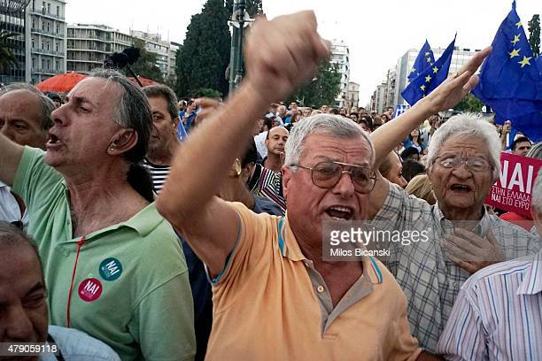 Demonstrators during a rally organized by supporters of the 'Yes' vote for the upcoming referendum in front of the Greek Parliament on June 30 2015...