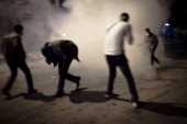 Demonstrators engage in street battles with Egyptian security forces on Mohamed Mahmoud Street in downtown Cairo on November 23 2011 in Cairo Egypt
