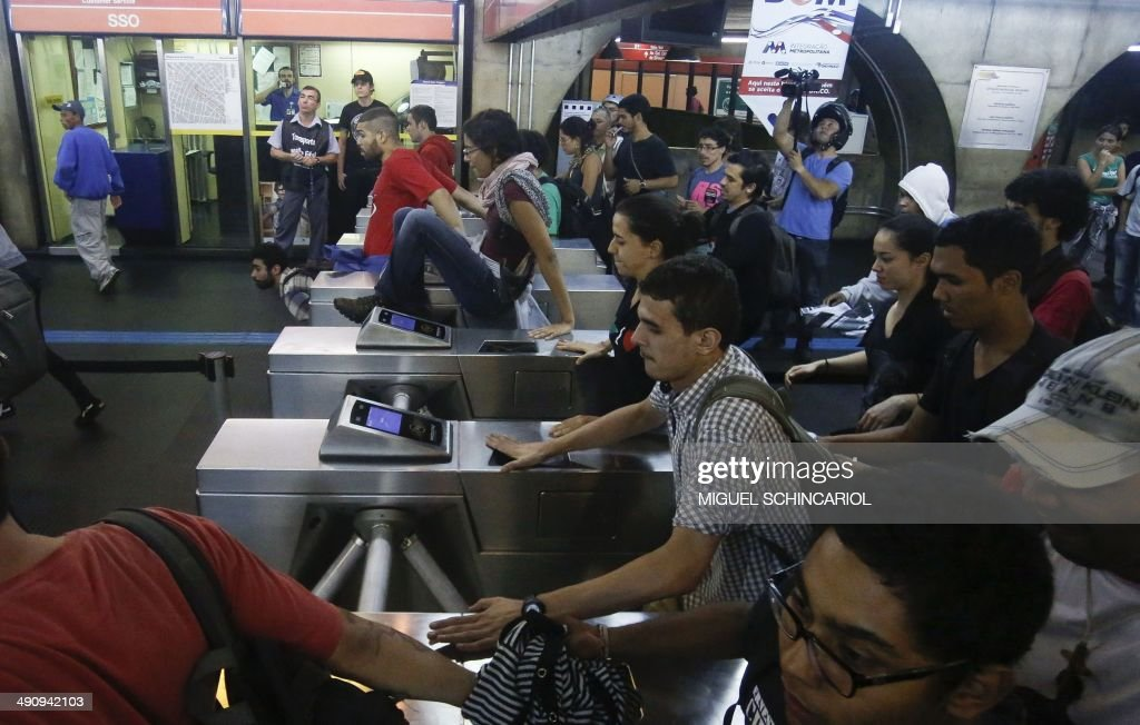 Demonstrators enter the subway without paying during the 'International Day of World Cup Resistance' against the upcoming FIFA World Cup Brazil 2014 in Sao Paulo, Brazil on May 15, 2014. AFP PHOTO /Miguel SCHINCARIOL