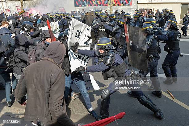 Demonstrators fighting with riot police during the parisian students demonstrate against the 'El Khomeri' law project on April 5 2016 in Paris France...
