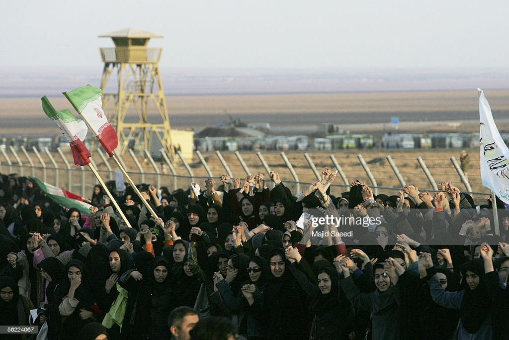 Demonstrators form a human chain around the Natanz uranium enrichment facility during a rally in support Iran's nuclear program November 18 2005 in...