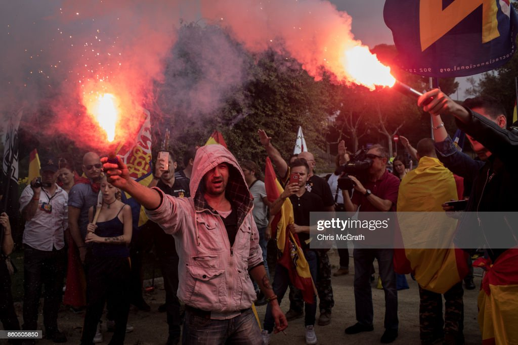 Demonstrators from Spanish far right groups light flares and chant slogans after marching from Plaza Espanya square on October 12, 2017 in Barcelona, Spain. The group marched on Spain's National Day chanting anti-separatist slogans to protest Catalonia's push for independence. Spain marked it's national day across the country amid high tension just days after Catalonia's president Carles Puigdemont addressed the Catalan Parliament where he acknowledged that his people voted for independence however suspended the declaration of independence for a few weeks, to have a reasonable dialogue, and mediation with the Spanish state.