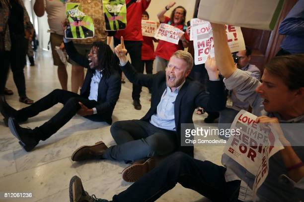 Demonstrators from Texas chant 'Kill the bill kill the bill' outside the offices of Sen Ted Cruz during a protest against health care reform...