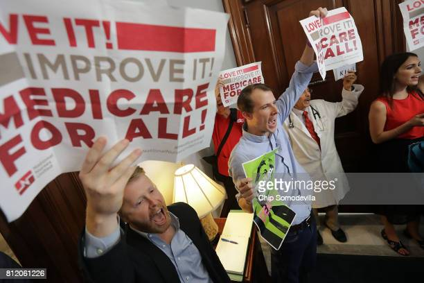 Demonstrators from Texas sit on the ground and chant 'Kill the bill kill the bill' inside the offices of Sen Ted Cruz while protesting against health...