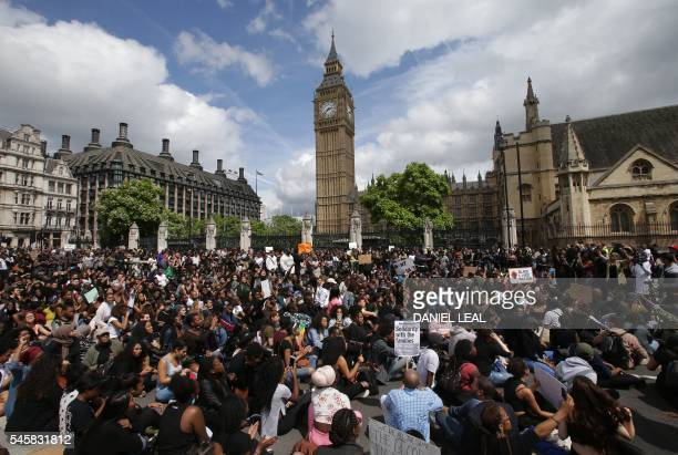 Demonstrators from the Black Lives Matter movement sit in the road on Parliament Square in central London on July 10 during a demonstration against...