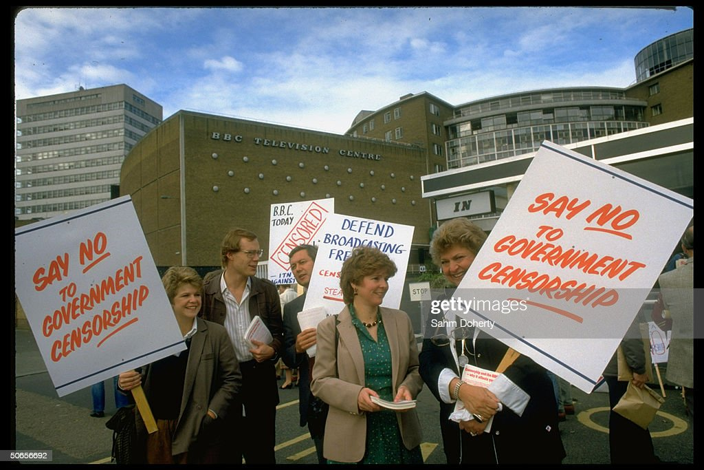 Demonstrators from the British Broadcasting Corporation (BBC) and Independent Television News (ITN) waving signs outside during media strike, re banned television footage on Northern Ireland.