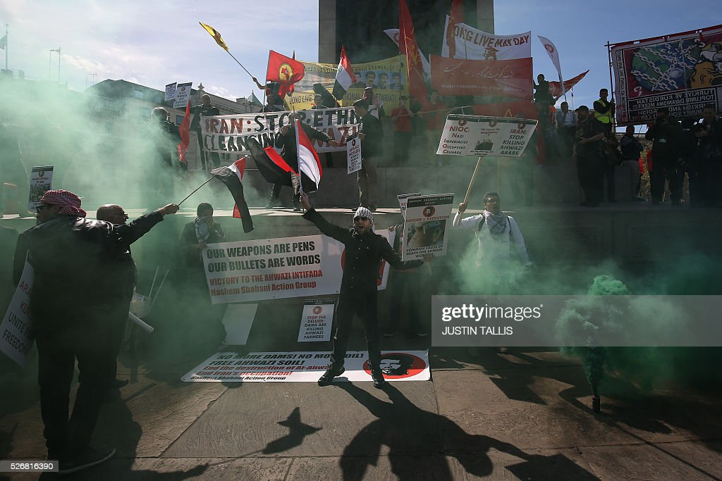 Demonstrators from the Democratic Party of Alahwaz protest in Trafalgar Square during a May Day rally in London on May 1, 2016. / AFP / JUSTIN