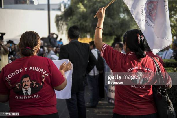 Demonstrators from the mine workers union hold flags during a protest ahead of the North American Free Trade Agreement renegotiations in Mexico City...