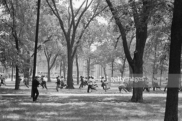 Demonstrators from the Sixteenth Street Baptist Church run across Kelley Ingram Park in Birmingham Alabama during a segregation protest | Location...
