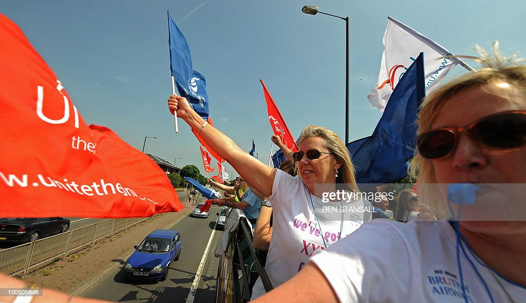 Demonstrators from the Unite union, ride on a double decker bus as they take part in a protest for striking British Airways cabin crew, on the second day of a five-day strike, at Heathrow Airport in west London on May 25, 2010. Thousands of air travellers faced renewed disruption on Tuesday as British Airways cabin crew continued a five-day strike, grounding many flights to and from its main London hub.