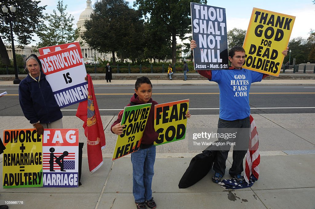 Demonstrators from the Westboro Baptist Church Betty Phelps Daniel Phelps and Jacob Phelps of Topeka Kansas gather outside the US Supreme Court as...