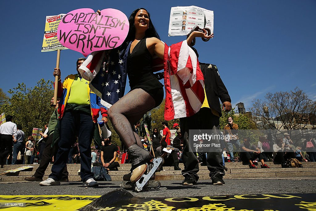 Demonstrators gather and prepare to march down Broadway on International Workers Day or Labor Day on May 1 2014 in New York City The annual global...
