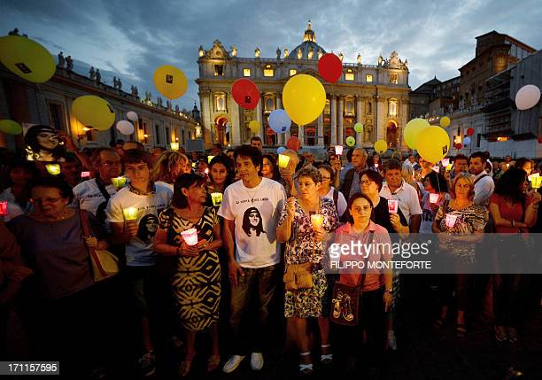 Demonstrators gather around Emanuela Orlandi's brother Pietro during a commemoration of the 30th anniversary of her disappearance in St Peter's...