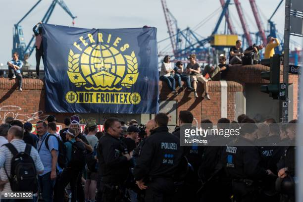 Demonstrators gather at Hamburg harbor prior to the 'Welcome to Hell' antiG20 protest march on July 6 2017 in Hamburg Germany Leaders of the G20...