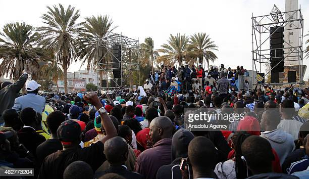 Demonstrators gather at Place de l'Obélisque to protest against Senegalese President Macky Sall during Senegalese Democratic Party's rally in Dakar...