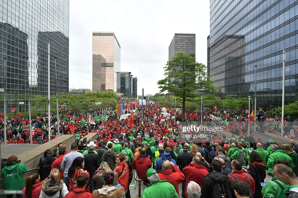 Demonstrators gather at the Brussels Noordstation-Gare du Nord for a national protest on May 24, 2016, in Brussels. Belgian trade unions called for mass protests against the centre-right government's proposed work reforms as they plan rallies and strikes over the next few months. / AFP / Belga / DIRK WAEM / Belgium OUT