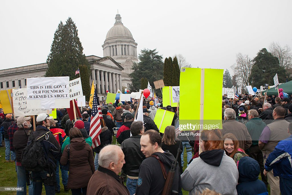 Demonstrators gather at the capitol building during a progun rally on January 19 2013 in Olympia Washington The Guns Across America national campaign...