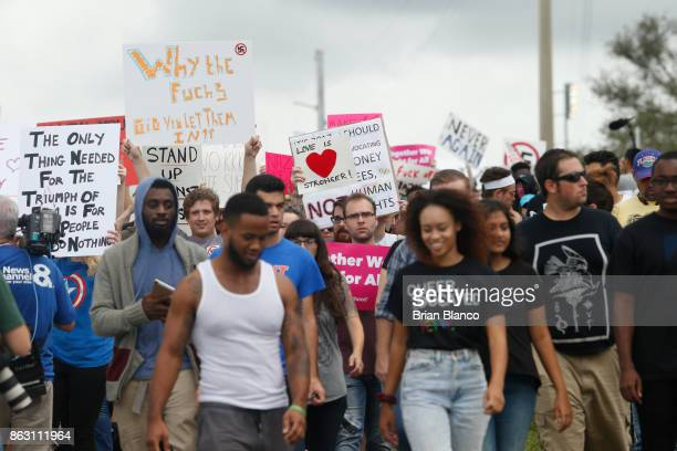 Demonstrators gather at the site of a planned speech by white nationalist Richard Spencer who popularized the term 'altright' at the University of...