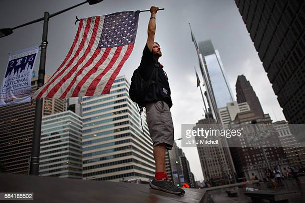 Demonstrators gather at Thomas Paine Plaza near City Hall on day four of the Democratic National Convention on July 28 2016 in Philadelphia...