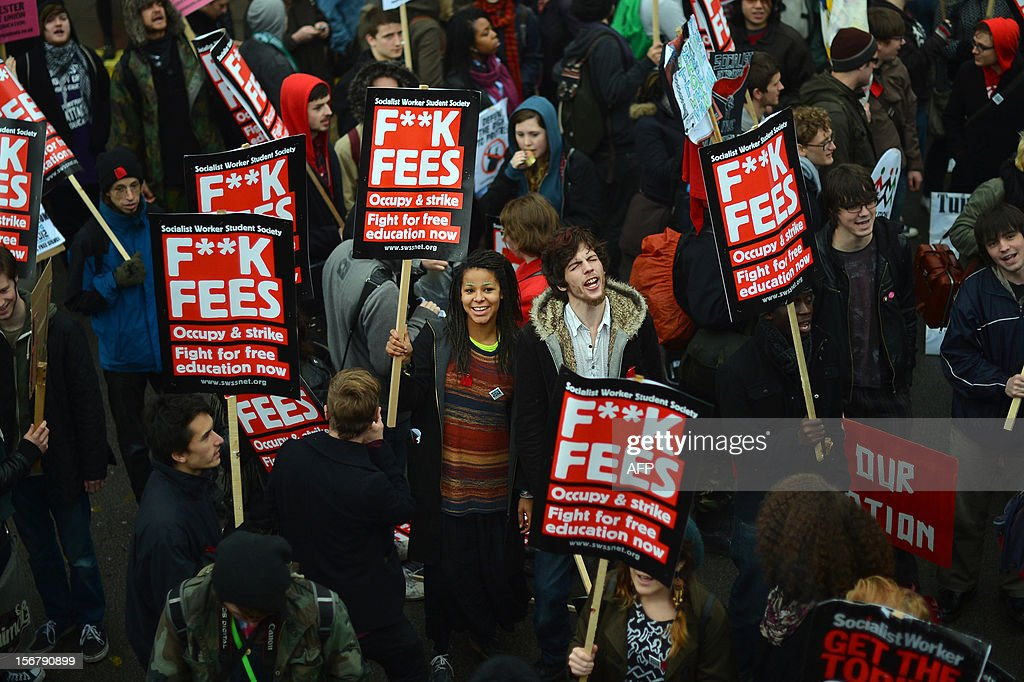 Demonstrators gather before the start of a student rally in central London on November 21, 2012 against sharp rises in university tuition fees, funding cuts and high youth unemployment.