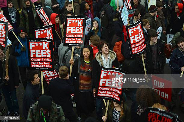 Demonstrators gather before the start of a student rally in central London on November 21 2012 against sharp rises in university tuition fees funding...