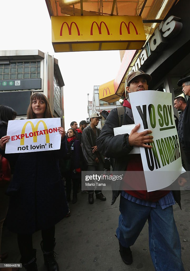 Demonstrators gather during a protest for better wages for fast food workers outside a McDonald's restaurant in Harlem on April 4, 2013 in New York City. Organizers said hundreds of fast food workers were expected to walk off the job today from establishments including Wendy's, McDonald's and KFC to rally for better pay and union rights.