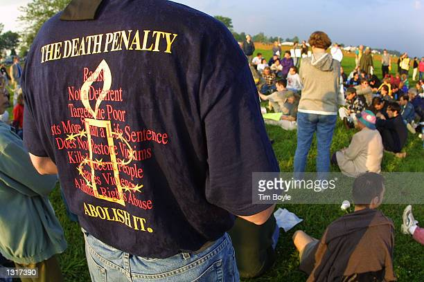 Demonstrators gather in an area reserved for antideath penalty protesters June 11 2001 outside the US Federal Penitentiary in Terre Haute Indiana...
