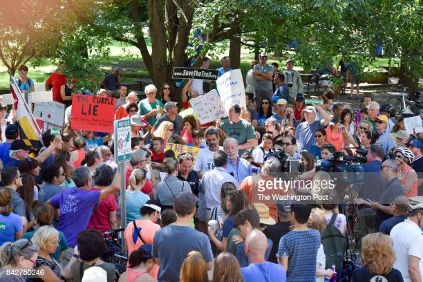 Demonstrators gather in Elm Street Park to protest the closing of the Capital Crescent Trail between Bethesda and Silver Spring on Monday September 4...