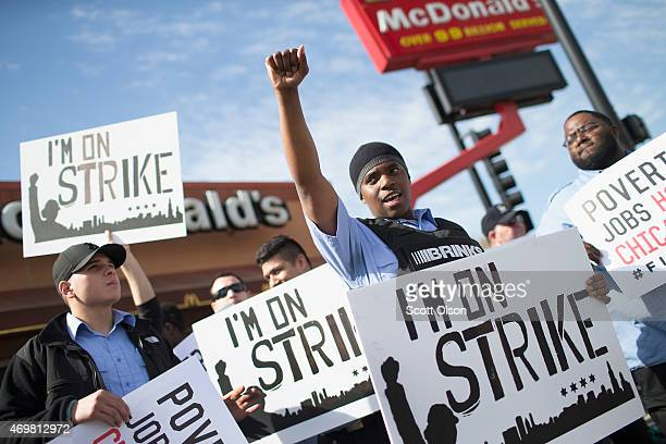 Demonstrators gather in front of a McDonald's restaurant to call for an increase in minimum wage on April 15 2015 in Chicago Illinois The...