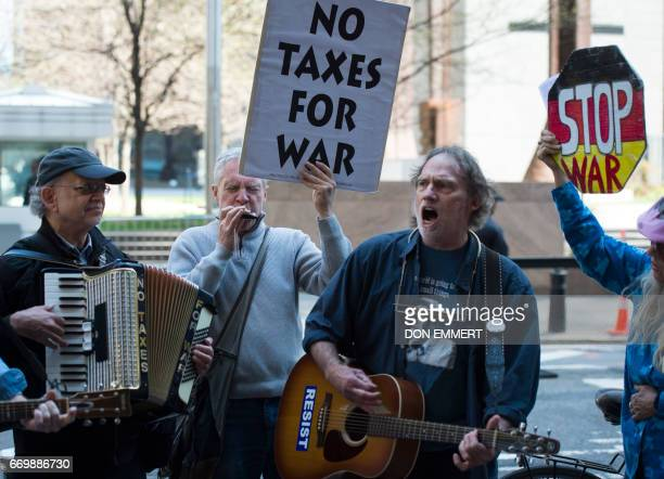 Demonstrators gather in front of the Internal Revenue Service building in Manhattan to protest tax dollars being spent on US wars and the military...