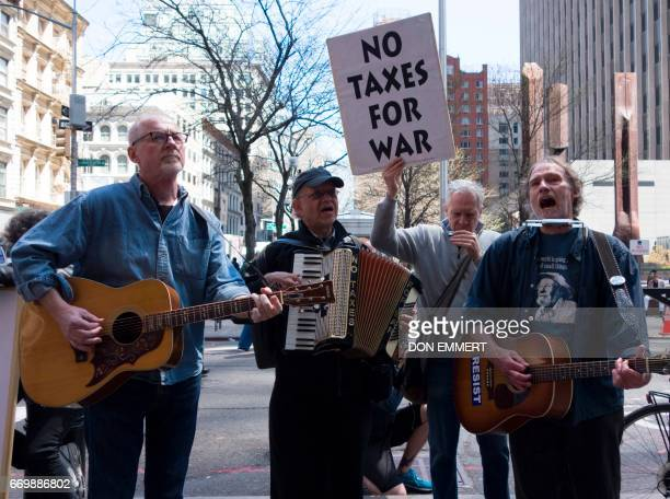 Demonstrators gather in front of the Internal Revenue Service building in Manhattan to protest tax dollars being spent on US wars and the military on...