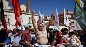 Demonstrators gather in front of the Portuguese parliament holding flags during a demonstration called by the CGTP union against the austerity...