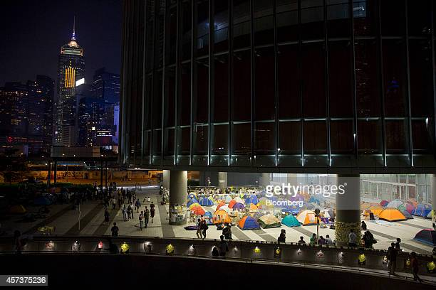 Demonstrators gather near tents outside Chief Executive Leung Chunying's office in the Admiralty business district Hong Kong China on Friday Oct 17...