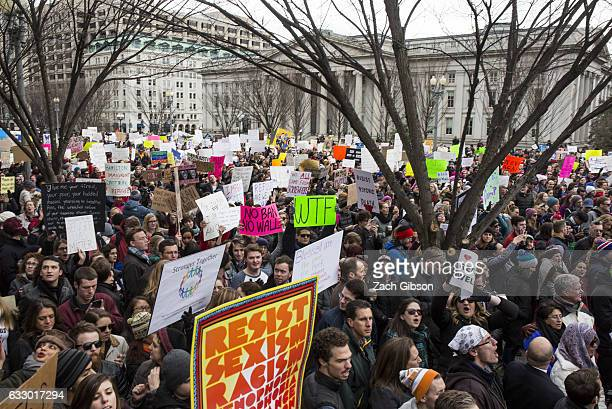 Demonstrators gather near The White House to protest President Donald Trump's travel ban on seven Muslim countries on January 29 2017 in Washington...