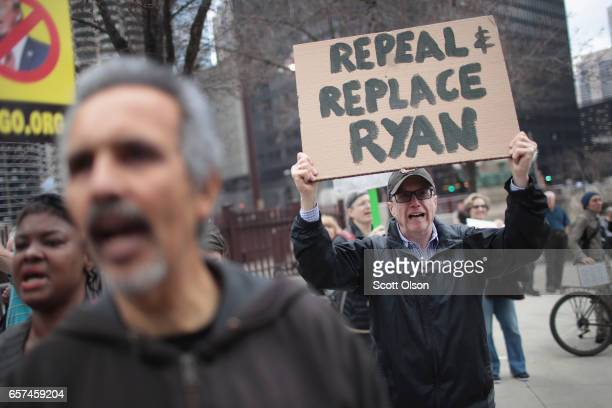 Demonstrators gather near Trump Tower to celebrate the defeat of President Donald Trump's revision of the Affordable Care Act on March 24 2017 in...