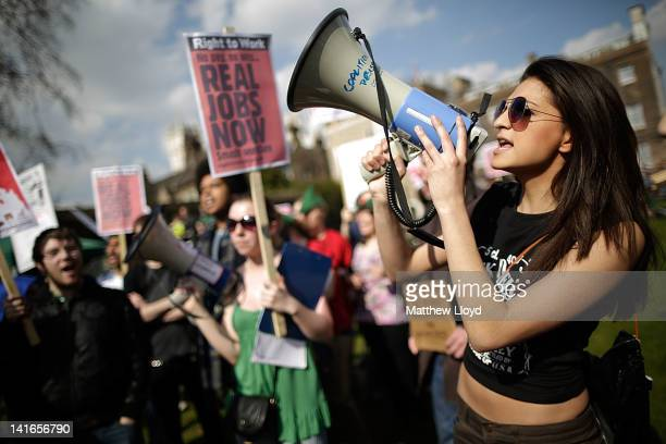 Demonstrators gather on College Green opposite the Houses of Parliament to protest against the Government's austerity measures as the Chancellor of...
