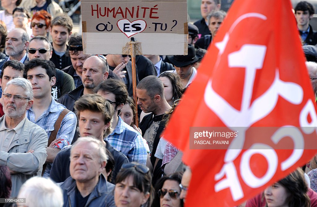 Demonstrators gather on June 6, 2013 in the southwestern town of Toulouse after a young far-left activist was killed during a fight with skinheads in central Paris. Clement Meric, an 18-year-old French far-left activist and student at the city's prestigious Sciences-Po university, died on June 6 following the fight. Clement Meric had been left brain dead after the violence on June 5. The police source said three men and one woman had been held and that the attacker who is thought to have dealt the fatal blow denied having an intention to kill. The board reads : 'Humanity, where are you ?'.
