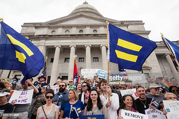 Demonstrators gather on the steps of the Arkansas State Capital in Little Rock during a press conference by the Human Rights Campaign following Gov...