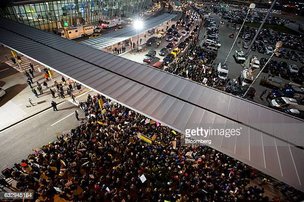 Demonstrators gather outside of John F Kennedy International Airport airport to protest US President Donald Trump's executive order blocking visitors...
