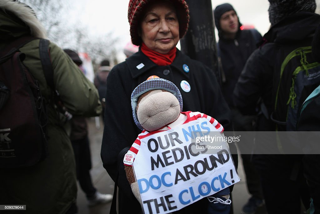Demonstrators gather outside St Thomas's Hospital on February 6, 2016, in London, England. Junior Doctors across the United Kingdom began a 24 hour strike today over the British governments' plans to change contracts for junior doctors. Doctors have claimed that Prime Minister David Cameron's government is not providing enough resources for the state-run National Health Service (NHS), which was founded by a socialist government in 1948 to provide free health care at the point of delivery.