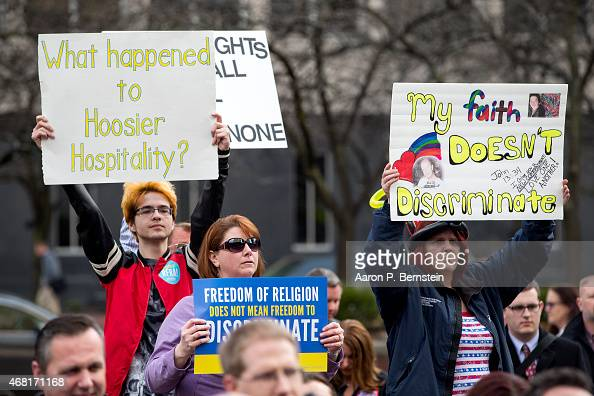 Demonstrators gather outside the City County Building on March 30 2015 in Indianapolis Indiana The group called on the state house to roll back the...