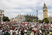 Demonstrators gather outside the Houses of Parliament after marching from outside the Israeli embassy in central London on July 26 calling for an end...