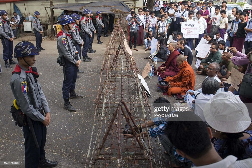 Demonstrators gather outside the Thai embassy in Yangon on December 26 2015 to protest against the death sentence of Myanmar labour workers Zaw Lin...
