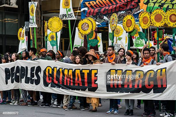 Demonstrators gather prior to the start of the People's Climate March in New York US on Sunday Sept 21 2014 The United Nations 2014 Climate Summit is...