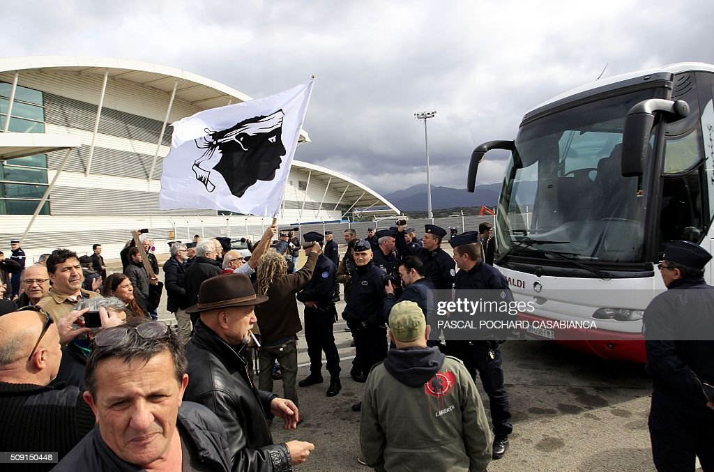 Demonstrators gather to block the exit of buses from the airport in Ajaccio on February 9, 2016, carrying attendees of a seminar by extreme right-wing organisations. CASABIANCA