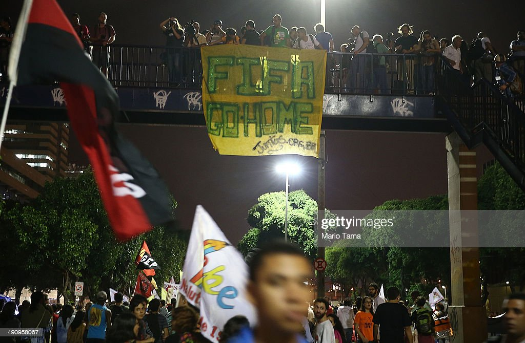 Demonstrators gather with onlookers at a protest against the upcoming 2014 World Cup on May 15, 2014 in Rio de Janeiro, Brazil. Anti-World Cup demonstrations were held across the country today.